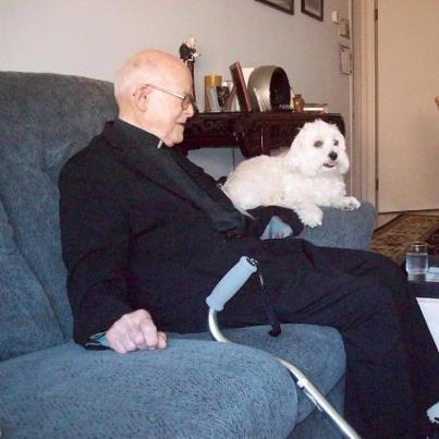 Fr John Harvey with dog Aby at St Norbert's Rectory, Toronto
